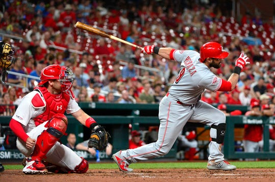 Jun 4, 2019; St. Louis, MO, USA; Cincinnati Reds left fielder Jose Peraza (9) hits a one run double off of St. Louis Cardinals starting pitcher Genesis Cabrera (not pictured) during the fourth inning at Busch Stadium. Mandatory Credit: Jeff Curry-USA TODAY Sports