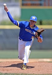Moeller pitcher Cameron Junker brings the heat against Milford.