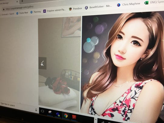 A photograph of the YoYo Massage website shows roses on a towel in one photograph and the image of a young Asian woman in another photograph. Boone County Sheriff's Office investigators were at the massage parlor on Burlington Pike Wednesday.
