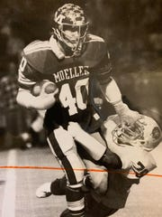 Moeller's Bob Crable shakes off a would-be tackler as he runs back a pass interception in an October 1977 game.