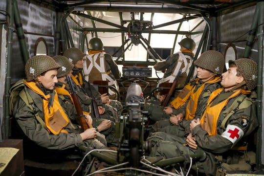 A display of soldiers dressed for D-Day sits inside a glider that was used during the operation at the Pratt Museum in Fort Campbell, KY., on Tuesday, June 4, 2019.