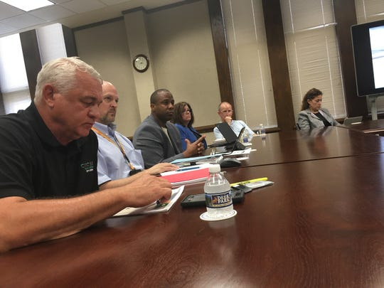 Clarksville-Montgomery County Schools Director Millard House, center, flanked by members of his staff, appeals Wednesday to the county Budget Committee.