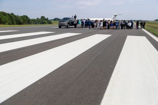 A large group gathers for the ribbon cutting ceremony on a new runway at the Clarksville Regional Airport in Clarksville, Tenn., on Tuesday, June 4, 2019.