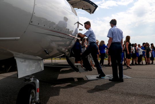 Pilots in training jump on board of a jet used as a display at the new runway installment at the Clarksville Regional Airport in Clarksville, Tenn., on Tuesday, June 4, 2019.