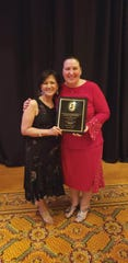 Evangeline Villanueva (left), director of Nursing at Reformed Church Home, congratulates Vera Yarmoliouk, RN, for receiving the RN Employee of the Year Award from the New Jersey Association of Directors of Nursing in Long Term Care (NJADONA/LTC) during the April 8annual nursing convention.