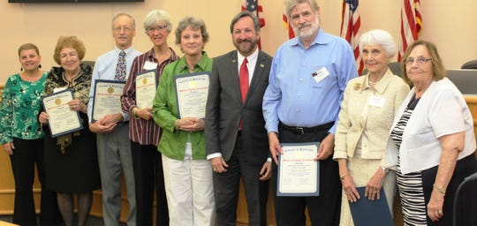 Seven individuals selected for the 2019 Profiles of Positive Aging Award were honored by the Somerset County Board of Chosen Freeholders at a public meeting in May. (Left to right) Office on Aging and Disability Services Executive Director Joanne Fetzko; Profiles of Positive Aging recipients Helen Rebmann, Charles E. Windus, Frances Ellis, Lynn Franklin, Mike Schatzki, and Sondra Fechtner; Freeholder Brian D. Levine (center); and Eldercare Services Administrator Cynthia Voorhees (right).