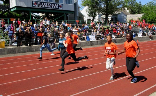 Elementary school students competing in the 50-meter dash at Linden Public Schools' annual Paul Blue Elementary Track and Field Meet.