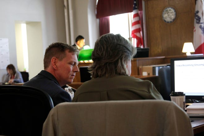 Former Iowa Workers' Compensation Commissioner Chris Godfrey sits with his attorneys during opening statements in his discrimination case against former Gov. Terry Branstad on Wednesday, June 5, 2019. Godfrey has accused Branstad of asking him to resign and cutting his pay because he is gay.