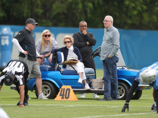 Lions GM Bob Quinn, owner Martha Firestone Ford and team president Rod Wood talk during minicamp on Wednesday, June 5, 2019, in Allen Park.