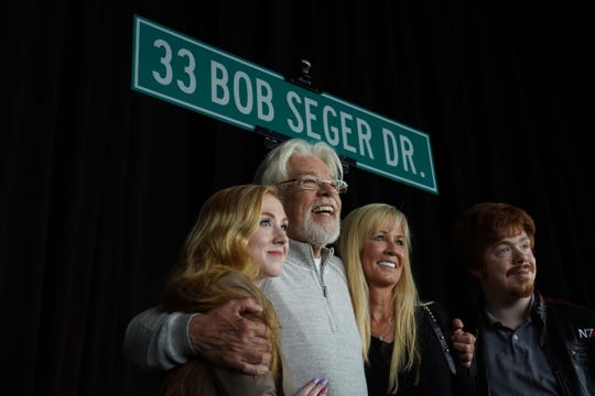 Bob Seger poses with his family at a ceremony to rename the address of DTE Energy Music Theatre as 33 Bob Seger Dr. on Wednesday, June 5, 2019.