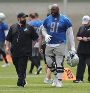 Lions coach Matt Patricia and Detroit defensive tackle A'Shawn Robinson walk off the field after minicamp on Wednesday, June 5, 2019, in Allen Park.
