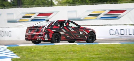 "General Motors president Mark Reuss piloted an early version of the ""track ready"" model of the upcoming Cadillac CT5-V high-performance sedan around the Indy Car road course on Detroit's Belle Isle park. (Photo by Richard Prince for Cadillac)"