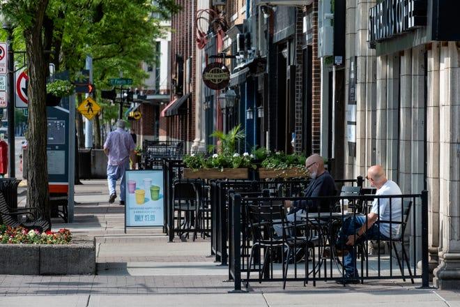 Looking down a sidewalk on Main Street in downtown Royal Oak on Tuesday, June 4, 2019.