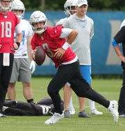 Lions quarterback Tom Savage goes through drills during minicamp on Wednesday, June 5, 2019, in Allen Park.