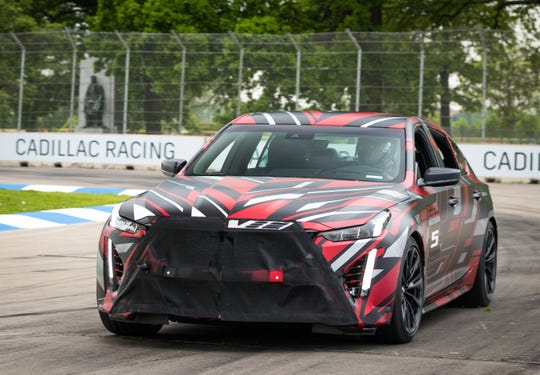 "General Motors president Mark Reuss piloted an early version of the ""track ready"" model of the upcoming Cadillac CT5-V high-performance sedan around the Indy Car road course on Detroit's Belle Isle park. (Photo by Eric Klauser for Cadillac)"
