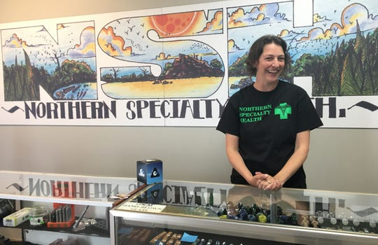 Co-owner of Northern Specialty Health Penny Milkey, poses for a photo at her store in Houghton on Friday, May 31, 2019. It's the only licensed dispensary in the Upper Peninsula and attracts customers several hours away.