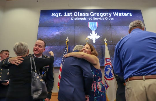 Sergeant First Class Gregory Waters greets attendees with his wife Jill Waters, after receiving the Distinguished Service Cross award during a ceremony at Selfridge Air National Guard Base in Harrison Twp., Mich. on Wednesday, June 5, 2019. Waters is receiving the medal for heroism as a medic in Afghanistan in 2008.