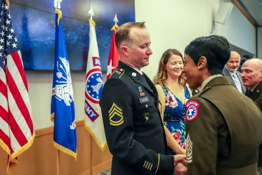 Sergeant First Class Gregory Waters shakes hands with U.S. Army Command Sgt. Major Tabitha A. Gavia after receiving the Distinguished Service Cross award during a ceremony at Selfridge Air National Guard Base in HarrisonTwp., Mich. on Wednesday, June 5, 2019. Waters is receiving the medal for heroism as a medic in Afghanistan in 2008.