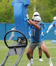 Lions linebacker Jahlani Tavai goes through drills during minicamp on Wednesday, June 5, 2019, in Allen Park.