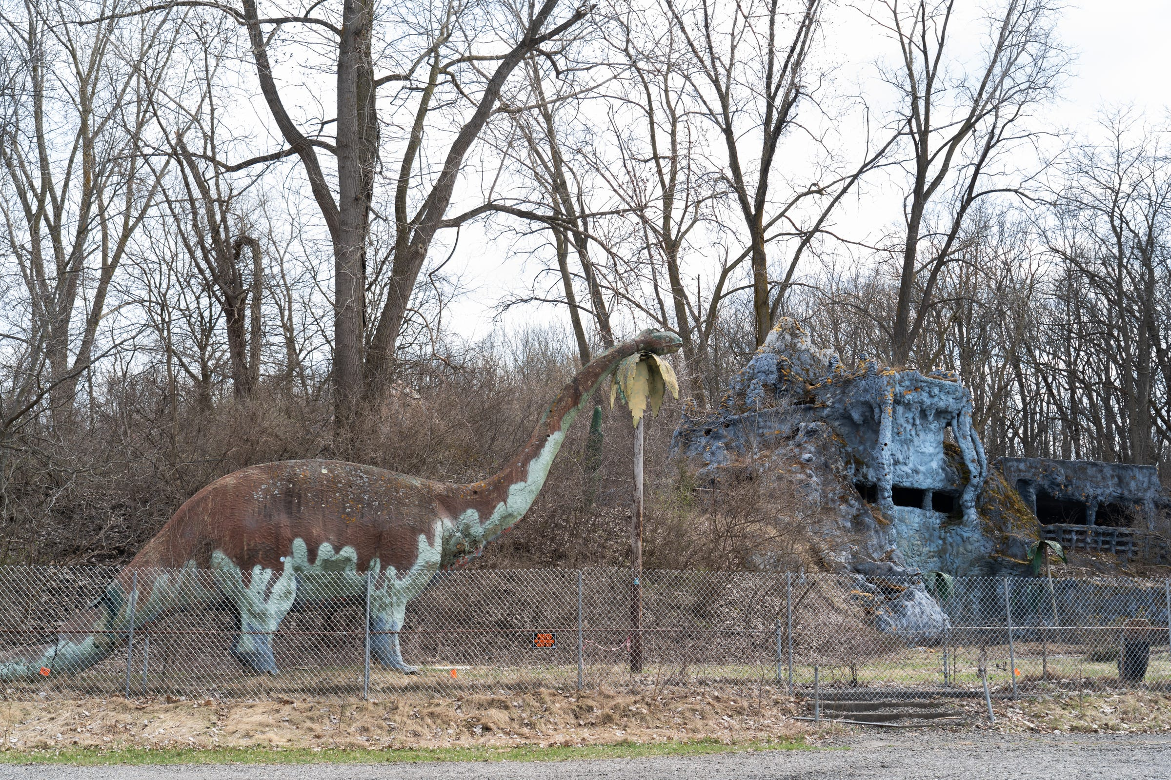 A large Brontosaurus stands at the entrance of Prehistoric Forest, a former roadside attraction in Irish Hills, on Tuesday, April 16, 2019.