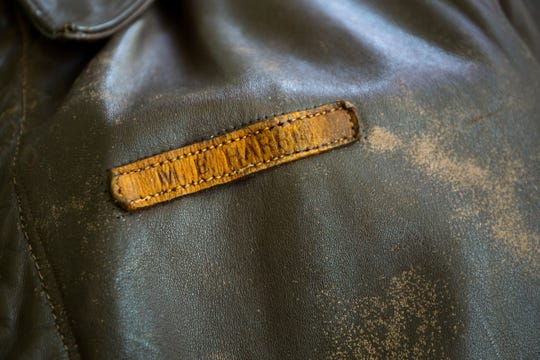 The bomber jacket worn by WWII vet and American Axle founder Mort Harris, 99, throughout the war is kept at his home in Bloomfield Hills on Monday, June 3, 2019. Harris was wearing the jacket when he was shot down in front of the White Cliffs of Dover during the war.