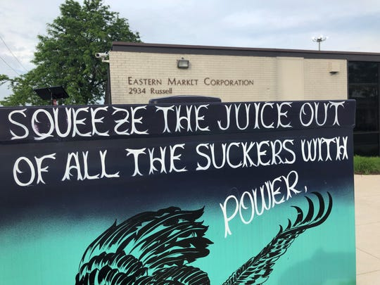 Anti-gentrification street art is popping up in Eastern Market as millions in private investment has many in the historic neighborhood on edge.