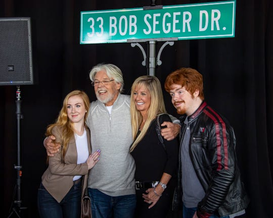 From left, daughter Samantha, Bob Seger,  wife Nita and son Cole pose for pictures during the street sign commemoration ceremony at DTE Wednesday.