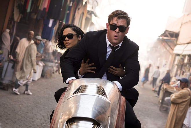 "Tessa Thompson and Chris Hemsworth in ""Men in Black: International."""