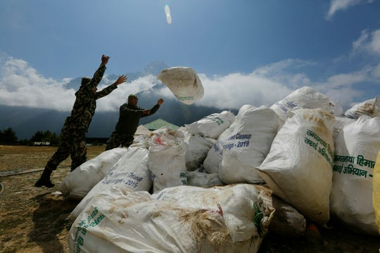 Nepalese army men pile up the garbage collected from Mount Everest in Namche Bajar, Solukhumbu district, Nepal, Monday, May 27, 2019. The garbage will be sent to Kathmandu for recycling.