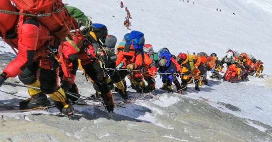 A long queue of mountain climbers line a path on Mount Everest just below camp four, in Nepal on May 22, 2019.