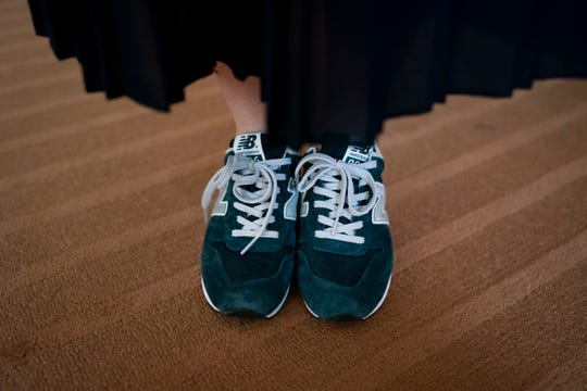 Yumi Ishikawa, a 32-year-old actress and writer, wears a pair of blue New Balance sneakers in Tokyo.