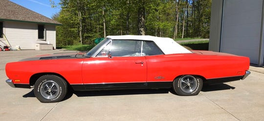 In a May 21, 2019 handout photo from the Leelanau County Sheriff, a 1969 Plymouth GTX convertible is seen. The sheriff's office in northern Michigan is auctioning some rare muscle.