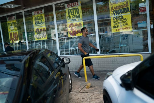 Fernando Schreiner walks to a local supermarket in Niteroi, Brazil. Conversations are rare for Schreiner, as he speaks no Portuguese and few people here speak anything but Portuguese.
