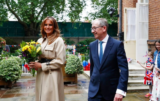 Philip May, husband of Britain's Prime Minister Theresa May, and first lady Melania Trump, wife of U.S President Donald Trump attend a garden party at 10 Downing Street in central London, Tuesday, June 4, 2019.