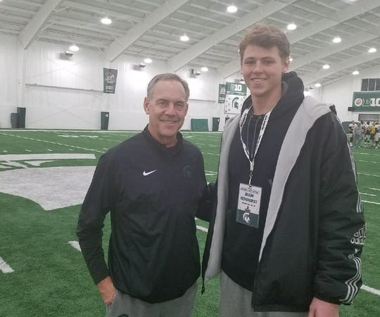Adam Berghorst, shown here with Michigan State head football coach Mark Dantonio, was selected in the 14th round of the MLB Draft by the Texas Rangers.