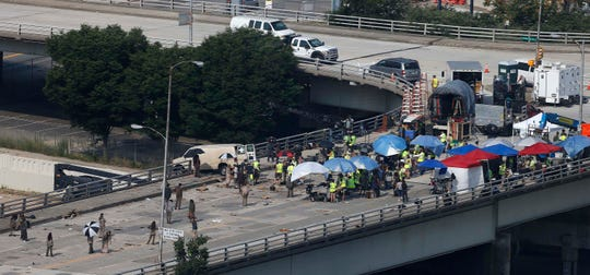 """Actors and extras work during filming of the """"The Walking Dead,"""" in Atlanta. The network behind the show that's become synonymous with Georgia says it will """"reevaluate"""" its activity in the state if a new abortion law goes into effect."""