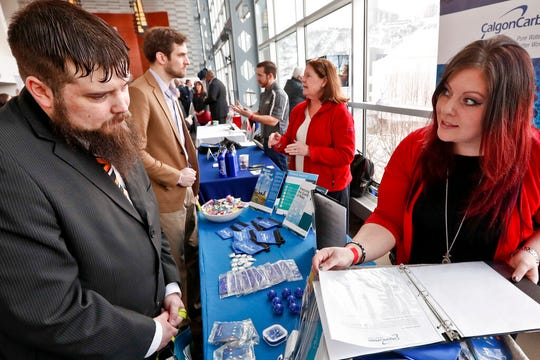 Visitors to a March Pittsburgh veterans job fair meet with recruiters at Heinz Field in Pittsburgh.