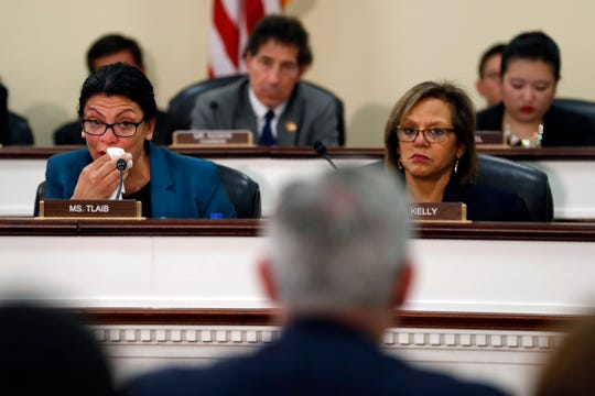 Rep. Rashida Tlaib, D-Mich., left, wipes away a tear after becoming emotional while recounting threats she has received in office because of her Muslim faith.