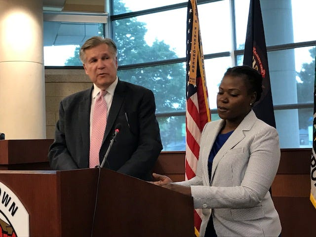 City Attorney Robert Ihrie and City Councilmember Monique Owens discuss a settlement in a federal lawsuit over the rights of black voters Tuesday after a special meeting.