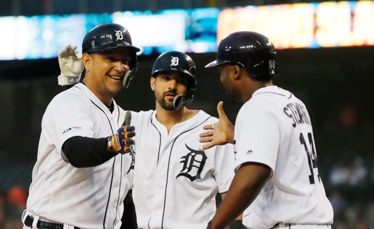 Miguel Cabrera, left, is greeted by Nicholas Castellanos, center, and Christin Stewart after hitting a grand slam during the fifth inning of Tuesday's 9-6 win.