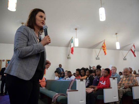 Gov. Gretchen Whitmer addresses residents of Benton Harbor at a local church during a special community meeting on Wednesday over the future of the city's high school.