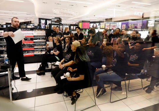Sephora employees gather in one of the company's closed stores, in New York, Wednesday, June 5, 2019.