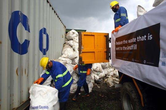 Workers load garbage which was collected from Mount Everest in trucks in Kathmandu, Nepal, Wednesday, June 5, 2019.