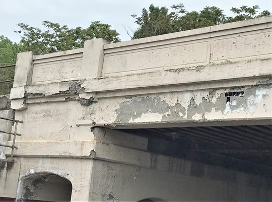 Crumbling concrete and peeling paint mar the appearance of the Norfolk Southern railroad viaduct over Fifth Street in Elmira.