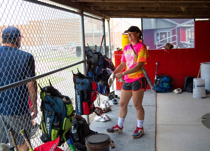 Tecumseh freshman Kaybree Oxley pulls on her batting gloves as she and her teammates prepare for practice Tuesday evening. The young team is prepared to take on No. 1 Bremen in the 2A state championship in Indianapolis Saturday.