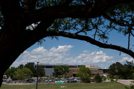Buildings can be seen through the trees on Wednesday, June 5, 2019, at Hewlett-Packard's Harmony Road campus in Fort Collins, Colo.