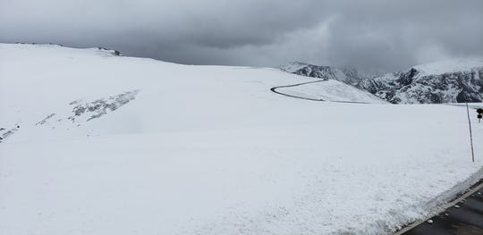 Late spring snows delayed the opening of Rocky Mountain National Park's Trail Ridge Road until Tuesday, which was the latest opening since 2011.