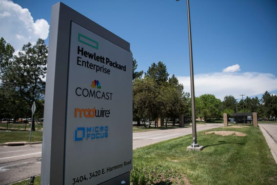 Signs at an entrance show companies occupying building space on Wednesday, June 5, 2019, at Hewlett-Packard's Harmony Road campus in Fort Collins, Colo.