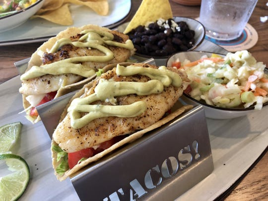 Grilled snapper tacos ($14) with tomato, lettuce, citrus slaw and avocado crema  from Tino's Southwest Kitchen in south Fort Myers.