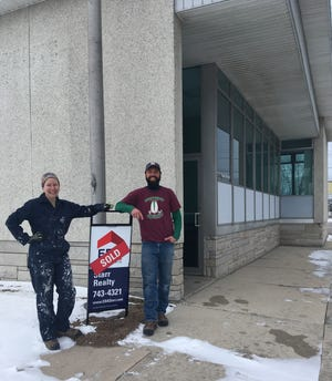 Kendra Bulgrin and Jimmy Eddings outside their the James May North gallery and events space in the former Algoma Post Office building at 219 Steele St.